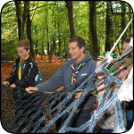 Bear Grylls encouraging Cubs on Unit assault course